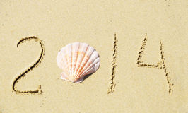 Number 2014 on sandy beach - holiday concept Stock Photography