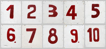 Number set. On white plywood board, hand written red digits Stock Photography
