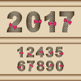 2017 number set with red ribbon. Shiny gold number set with black holes motive and red ribbon .This new number style is good for anniversary design element or Royalty Free Stock Image