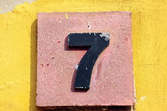 Number seven. On a stone board Stock Image