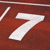 Number seven. Close up of number seven on a running-track Royalty Free Stock Photos
