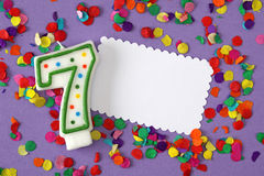 Number seven birthday candle. On lilac background Stock Photography