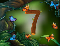 Number seven with 7 butterflies in the garden Stock Images