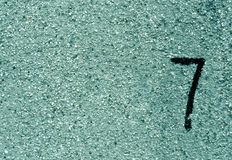Number seven on cyan grunge wall surface. Stock Photo
