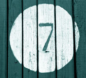 Number seven on cyan toned wooden wall Stock Photos