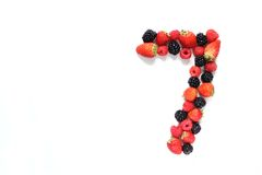 Number seven with fruits. Number seven made from strawberry, raspberry and blackberry fresh fruits Royalty Free Stock Images