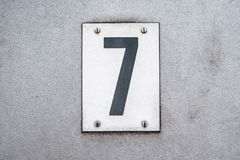 Number 7 / seven on metal background / house number - stock image