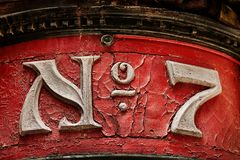 Number Seven. Ornate number seven on exterior building facade Royalty Free Stock Photos