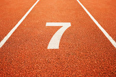 Number seven on running track. Number seven on athletics all weather running track Royalty Free Stock Photos