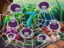 Number 7 with seven spiders on web Stock Photography