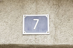 Number seven on a wall stock images