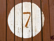 Number seven on wooden wall. Royalty Free Stock Image