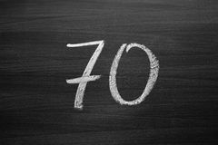Number seventy enumeration written with a chalk on the blackboard Royalty Free Stock Images