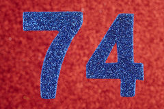 Number seventy-four blue color over a red background. Anniversar. Y. Horizontal Royalty Free Stock Photo