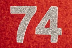 Number seventy-four silver color over a red background. Annivers. Ary. Horizontal Royalty Free Stock Images