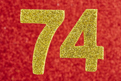 Number seventy-four yellow color over a red background. Annivers. Ary. Horizontal Royalty Free Stock Photography