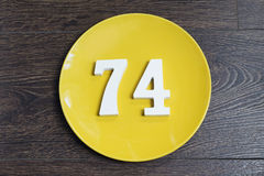 The number seventy-four on the yellow plate. Stock Photography