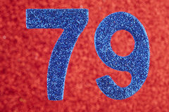Number seventy-nine blue color over a red background. Anniversar. Y. Birthday Royalty Free Stock Image