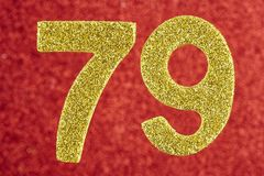 Number seventy-nine golden color over a red background. Annivers. Ary. Birthday Stock Images