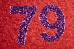 Number seventy-nine purple color over a red background. Annivers. Ary. Birthday Stock Photo