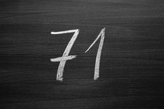 Number seventy one enumeration written with a chalk on the blackboard Stock Photos
