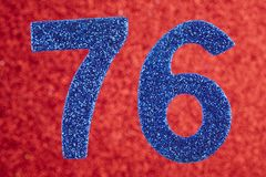Number seventy-six blue color over a red background. Anniversary. Horizontal Stock Photo