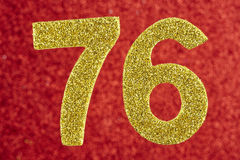 Number seventy-six yellow color over a red background. Anniversa. Ry. Horizontal Royalty Free Stock Image