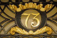Number Seventy Three. Ornate metal sign for number 73 on the exterior of a Georgian townhouse in central London Stock Images