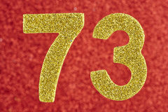 Number seventy-three yellow color over a red background. Anniver Royalty Free Stock Photos