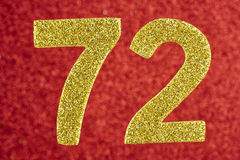 Number seventy-two yellow color over a red background. Anniversa. Ry. Horizontal Stock Photo