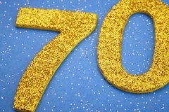 Number seventy yellow color over a blue background. Anniversary. Horizontal Royalty Free Stock Image