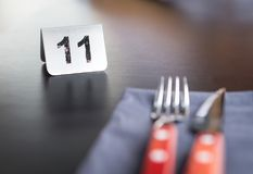 Number sign on restaurant table to show reservation. Royalty Free Stock Photography