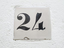 Number 24 sign. Street slab black and white Stock Image