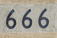 Number 666 sign and symbol. Display number 666 sign and symbol on a wall background. Concept photo of religion, hell, satan, superstition, belief Stock Photo