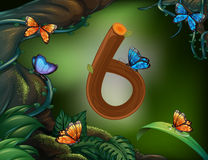 Number six with 6 butterflies in the garden Royalty Free Stock Photo