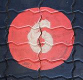 The number six in a circle is on the footpath playground. This is the number six what has painted on bricks royalty free stock photography