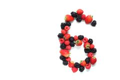 Number six with fruits. Number six made from strawberry, raspberry and blackberry fresh fruits Stock Photo