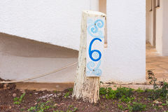 Number six 6 painted on wooden signboard Royalty Free Stock Image