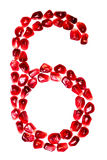 The number six pomegranate seeds isolated on white background. Royalty Free Stock Photos