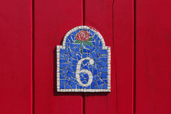 Number six. Red door with number six in mosaic, Island of sein, Finistere, Brittany, France Stock Photos
