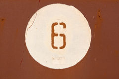 Number six on red metal wall. Royalty Free Stock Photo