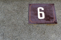 Number six. On a rusted metal plate Stock Photos