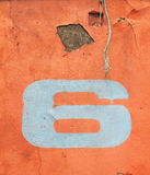 Number six on the walls orange Royalty Free Stock Photography