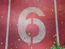 Number six was painted with white color. Royalty Free Stock Photos