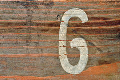 Number six wood background. Old wooden board with number six faded stencil. Wood grunge background Royalty Free Stock Photo