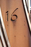 Number sixteen 16. Cut out in metal rusty plate in wooden frame Royalty Free Stock Photo
