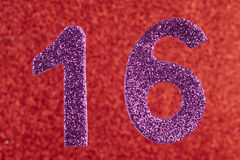 Number sixteen purple color over a red background. Anniversary. Stock Photos