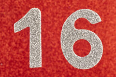Number sixteen white color over a red background. Anniversary. Stock Photography