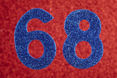 Number sixty-eight blue color over a red background. Anniversary Royalty Free Stock Photo