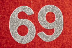 Number sixty-eight silver color over a red background. Anniversa Royalty Free Stock Image